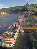 Pontoons at Moselle River. The pontoons for river cruise ships at the Moselle river, in the background the famous castle Reichsburg and the city of Cochem Stock Images