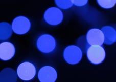 Pontos azuis em um fundo preto abstraia o fundo Fotografia de Stock
