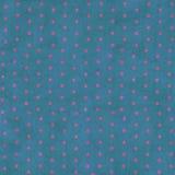 Pontos cor-de-rosa em um fundo azul de Grunge Fotos de Stock Royalty Free