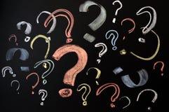 Pontos de interrogação coloridos Fotografia de Stock Royalty Free
