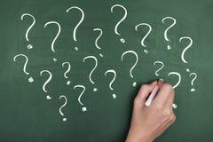 Pontos de interrogação da confusão Imagem de Stock Royalty Free