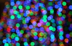 Pontos de luzes coloridos do Natal - teste padrão do bokeh Imagens de Stock Royalty Free