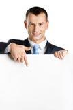 Pontos do homem de negócios no espaço da cópia em papel Fotos de Stock Royalty Free