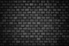 Ponury tło, czarny ściana z cegieł zmroku kamienia tekstura Fotografia Stock