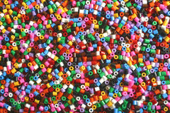 Pony beads. Some multi-coloured pony beads used for arts and crafts royalty free stock photo