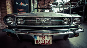 Pony car Ford Mustang. BERLIN - MAY 10, 2015: Pony car Ford Mustang (first generation). Stylization. Toning. 28th Berlin-Brandenburg Oldtimer Day royalty free stock image