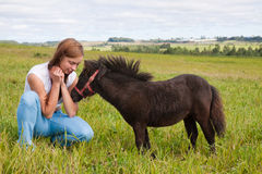 Pony and girl Royalty Free Stock Photography