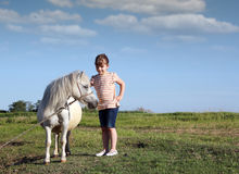 Pony horse and child Stock Photo