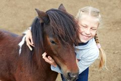 Pony and little girl and her best friend Royalty Free Stock Images