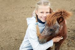 Pony and little girl and her best friend Stock Photos