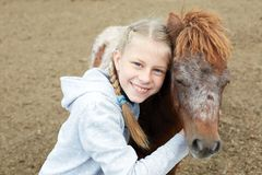 Pony and little girl and her best friend Stock Photo