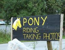 Pony riding sign. Along a road royalty free stock photos