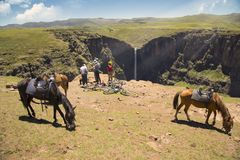 Pony trekking in Lesotho near Semonkong. Maletsunyane Falls Stock Photo