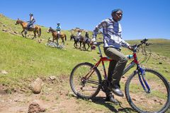 Pony trekking in Lesotho near Semonkong. Young local cyclist. Royalty Free Stock Image