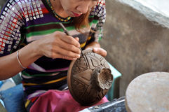 Pooducing the pottery. She is producing the pottery with soft clay in ancient Thai style at the famous pottery place at Pakkret n Nonthaburi,Thailand Royalty Free Stock Photo