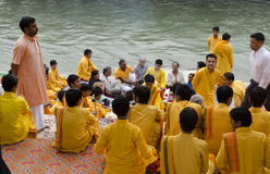 Pooja Ceremony. Young hermits performing the Pooja ceremony at the banks of the Ganges in the holy city of Rishikesh. This ritual has been going on since ages Royalty Free Stock Photography
