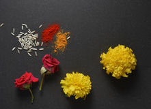 Pooja flower. Marigold flowers, rose and kumkum tilak. Indian religious festive background Stock Images