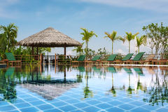 Pool. View of nice tropical pool  with exotic hut on the back Royalty Free Stock Photo