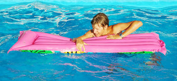 The pool. Young handsome man with pool mattress stock photography
