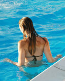 In the pool. Young woman in an outdoor pool in the sun Stock Photos
