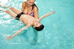 In pool. Photo of mother holding her son in swimming pool Stock Photo