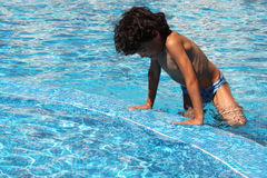 In the pool. Little boy is playing in the pool Royalty Free Stock Image