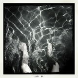 In the pool. Sitting on the edge of a pool - Taken with mobile phone Royalty Free Stock Photo
