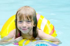 In the Pool!. Child playing in the swimming pool Royalty Free Stock Image