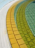 Pool. An outdoor swimming pool detail with yellow tile Royalty Free Stock Photos
