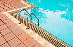 Pool. Photo of a swimming pool surrounded by brick floor Stock Images