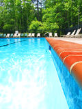 In The Pool. View along the edge of a large swimming pool Royalty Free Stock Photos