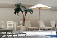 By the pool. Indoor swimming pool Royalty Free Stock Photo