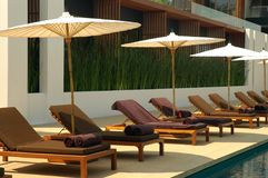 By the pool. Chaiselongue by the pool Stock Images