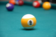 Pool. A pool ball on pool table Royalty Free Stock Photo