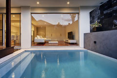 Pool Area. A courtyard pool area of a luxury home Stock Image