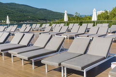 Pool area  with gray sunbeds in a row ,bodrum,turkey Royalty Free Stock Photo