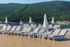 Pool area  with gray sunbeds in a row ,bodrum,turkey Stock Photo