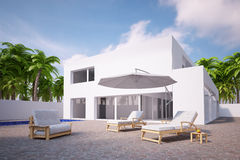 Pool area with house and palm trees Stock Photography
