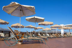 Pool area with umbrellas and chairs Stock Photos