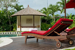 Pool in backyard. Pool in Bali villa backyard with sunbeds Royalty Free Stock Photo