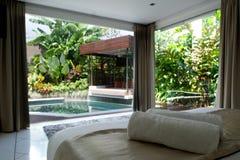 Pool in backyard. Pool in Bali villa backyard view from bed Royalty Free Stock Image