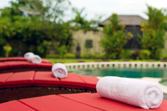 Pool in backyard with a towel. Pool in Bali villa backyard with sunbeds royalty free stock photography