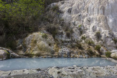 Pool of Bagni San Filippo hot springs. BAGNI SAN FILIPPO, ITALY - JUNE 2 2017: The free accessible pool of Bagni San Filippo hot springs in Italy with its Stock Images