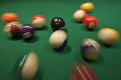Pool Ball Break. Slow shutter speed shot of a break in a pool game Royalty Free Stock Photography