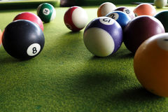 Pool ball. The colourful pool ball on the green background royalty free stock photo