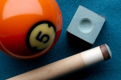 Pool ball, cue stick and chalk royalty free stock image