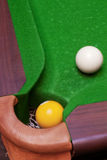Pool ball fallen into pocket Stock Photo