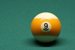 Pool ball number 09. In pool table royalty free stock photo