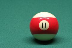 Pool ball number 11. In pool table royalty free stock images