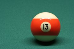 Pool ball number 13. In pool table stock photos